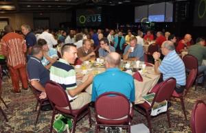 The delegates eating breakfast together.