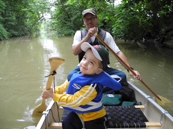 In the canoe with grandson Henry.