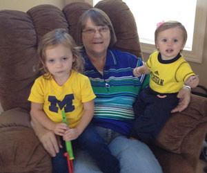 Sandy with grandchildren Zoe and Aubrey.