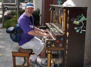 Playing on an old-time upright during a vacation in the Dakotas.